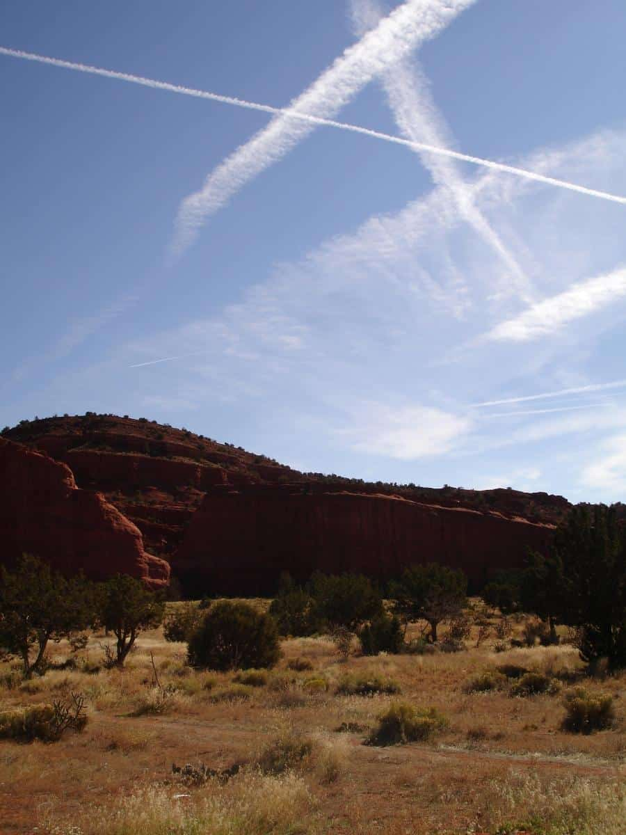 The Jemez Red Rocks at Walatowa, along with several contrails evident in the sky. Photo: Annette Olson, USGS. Public domain.