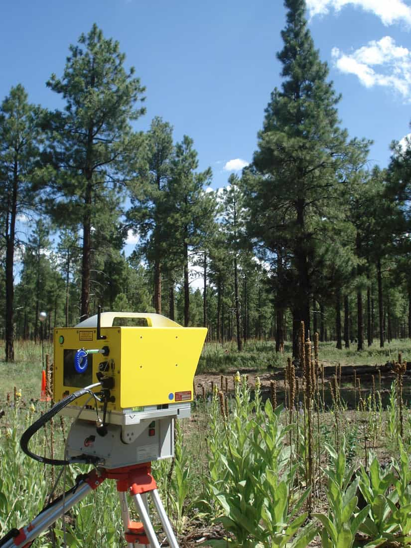 A LiDAR (Light Detection and Ranging) instrument measures the 3-D structure of a ponderosa pine forest stand in Coconino National Forest near Flagstaff, Arizona, on July 13, 2009. Photo: Dennis G. Dye, U.S. Geological Survey. Public domain.