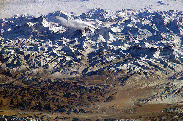 Himalaya from the International Space Station. In addition to looking heavenward, NASA helps the world see the Earth in ways no one else can. Astronauts on board the International Space Station recently took advantage of their unique vantage point to photograph the Himalayas, looking south from over the Tibetan Plateau. The perspective is illustrated by the summits of Makalu [left (8,462 metres; 27,765 feet)], Everest [middle (8,848 metres; 29,035 feet)] , Lhotse [middle (8,516 metres; 27,939 feet)] and Cho Oyu [right (8,201 metres; 26,906 feet)] -- at the heights typically flown by commercial aircraft.