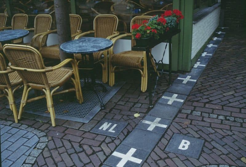 Café in Baarle-Nassau (Netherlands), on the border with Belgium. The border is marked on the ground.