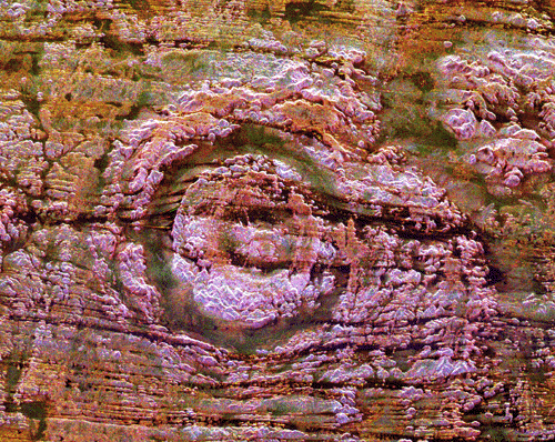 The impact of an asteroid or comet several hundred million years ago left scars in the landscape that are still visible in this spaceborne radar image of an area in the Sahara Desert of northern Chad. The concentric ring structure is the Aorounga impact crater, with a diameter of about 17 kilometers (10.5 miles). The original crater was buried by sediments, which were then partially eroded to reveal the current ring-like appearance.
