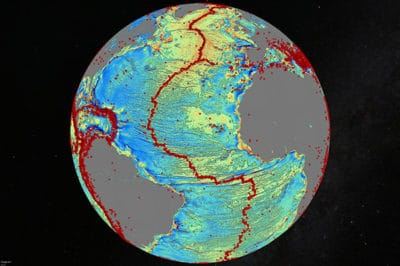Map of the North Atlantic Ocean showing gravity anomalies. Marine gravity model of the North Atlantic (10 mGal contours). Red dots show locations of earthquakes with magnitude > 5.5 and they highlight the present-day location of the seafloor spreading ridges and transform faults. This gravity information shows the details of the plate tectonic history of the rifting of these continents including the subtle signatures of fracture zones that are currently buried by sediment.