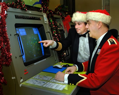 Col Pierre Ruel and BGen Christian Barabé check the radar screen in preparation for tracking Santa Claus in December of 2007.