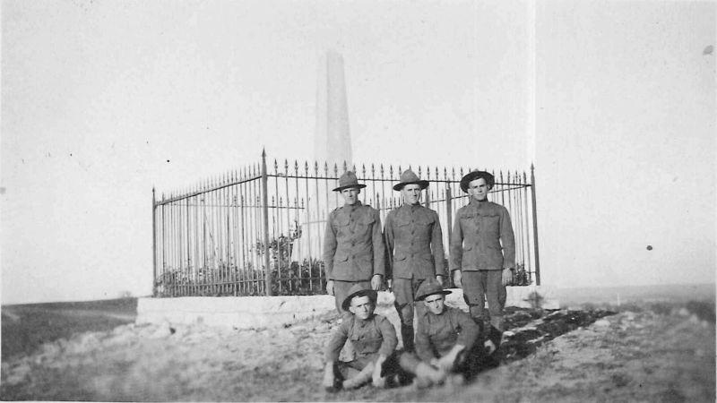 Soldiers posing in 1918 in front of the geographic center of the contiguous  United States near Lebanon, Kansas.  Photo: Mennonite Church USA Archives, no known copyright restrictions.
