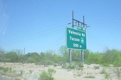 A road sign on Interstate 19 just south of Tucson taken April 18, 2005. Photo: NicAgent, Wikimedia.