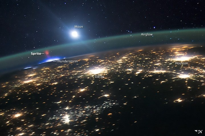 Astronauts aboard the International Space Station captured this view of a red sprite above the white light of an active thunderstorm high above Missouri or Illinois. Image: NASA, August 10, 2015.
