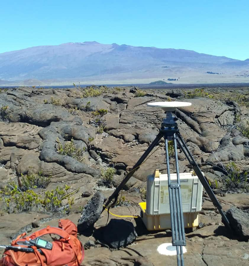 A high-precision Global Positioning System (GPS) survey is completed annually on Mauna Loa.  Photo: R. Kramer, USGS. Public domain.