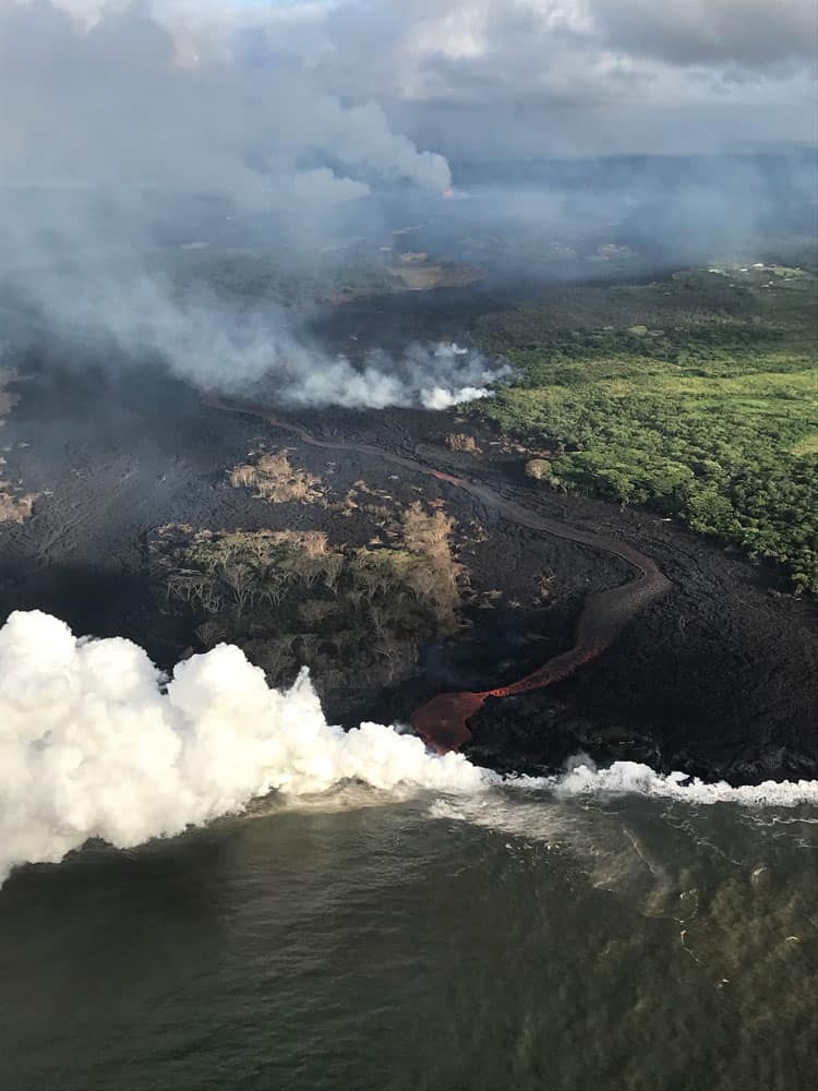 Aerial view of a channelized lava flow and active ocean entry. Image: USGS-HVO, May 22, 2018.