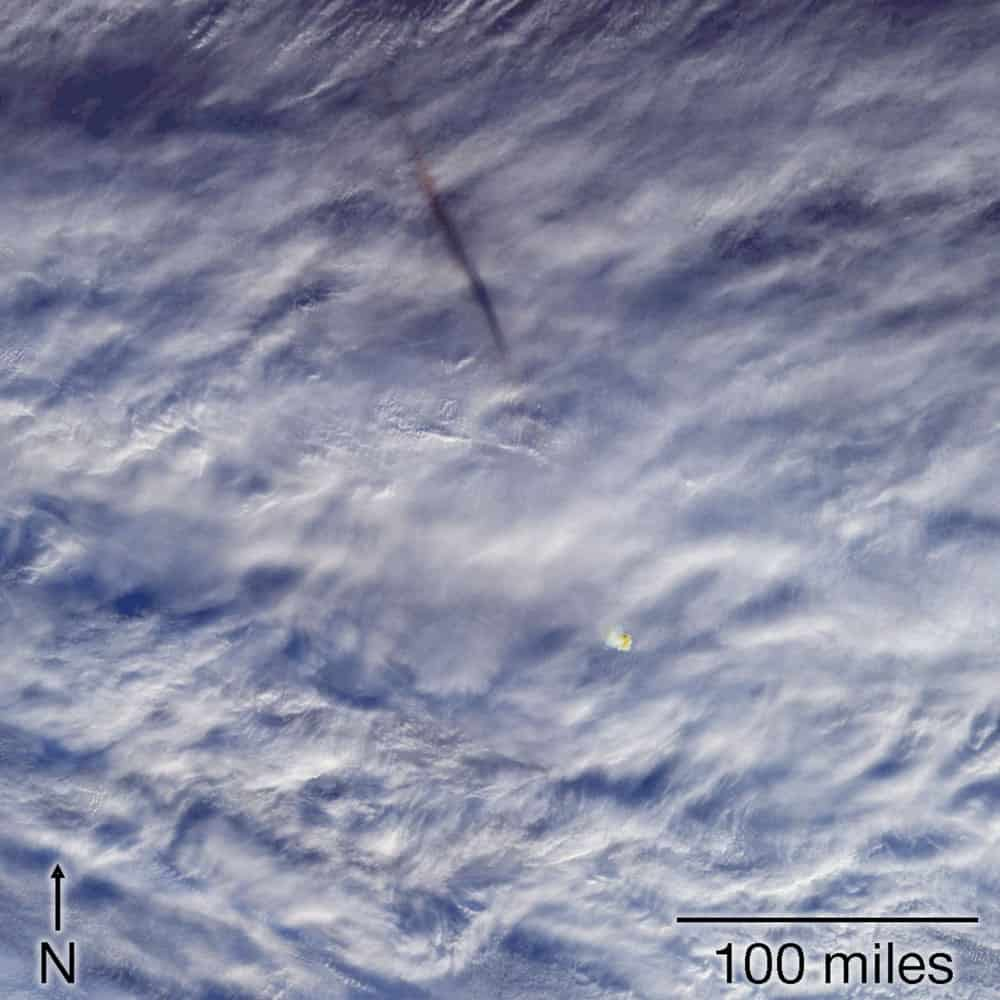 The trail of a fireball can be seen against the clouds over the Bering Sea on December 18, 2018. Source: NASA GSFC
