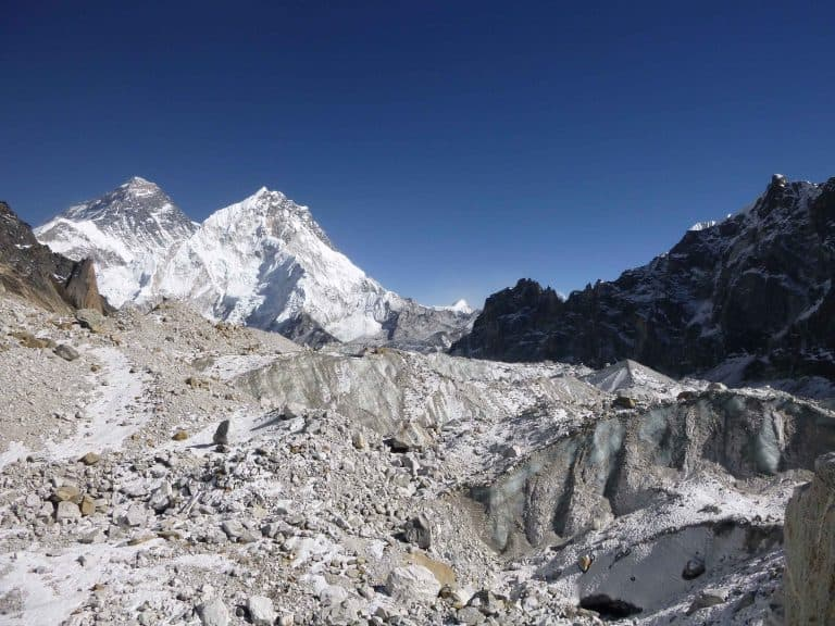 Much of Changri Nup Glacier is covered by rocky debris. The peak of Mt. Everest is in the background at left. Photo: Joshua Maurer via Columbia University