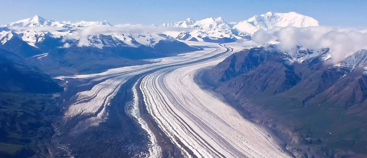 Nabesna Glacier in Wrangell-St Elias National Park and Preserve with Mt. Blackburn in the background. Photo: NPS/Bev Goad, public domain.