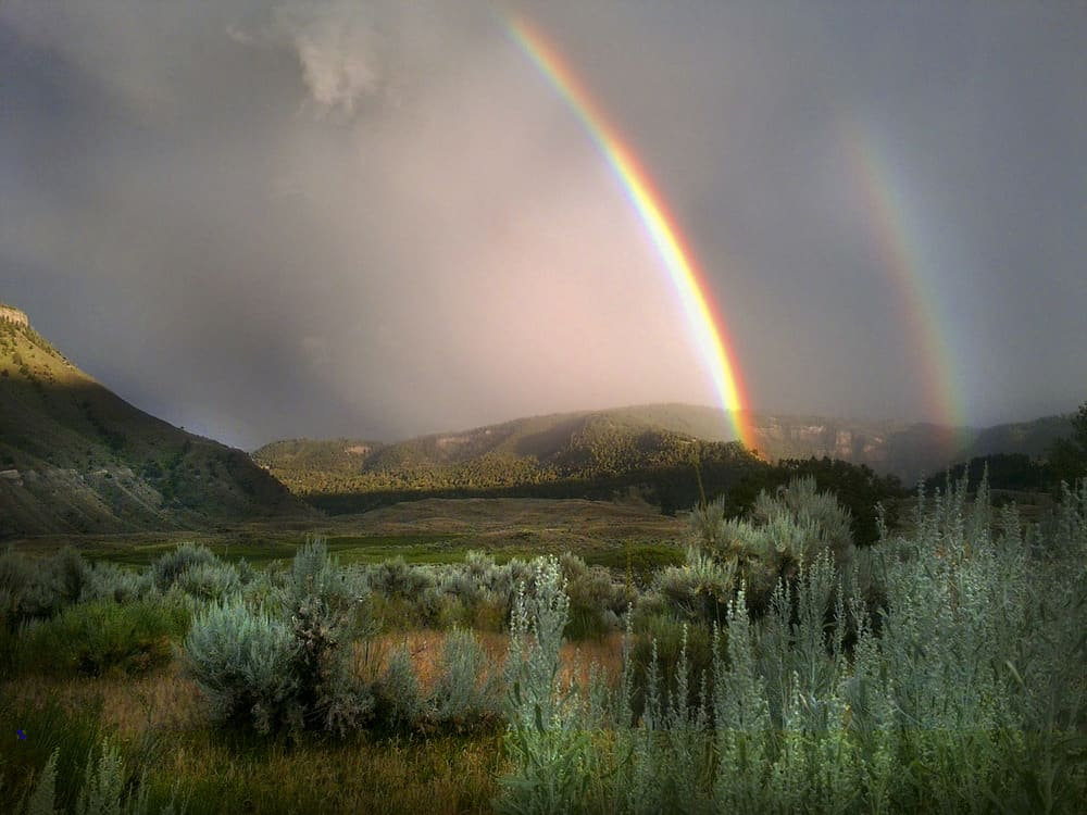 Double rainbow seen from Lower Mammoth in Yellowstone National Park. Photo: Dan Hottle/NPS, public domain.