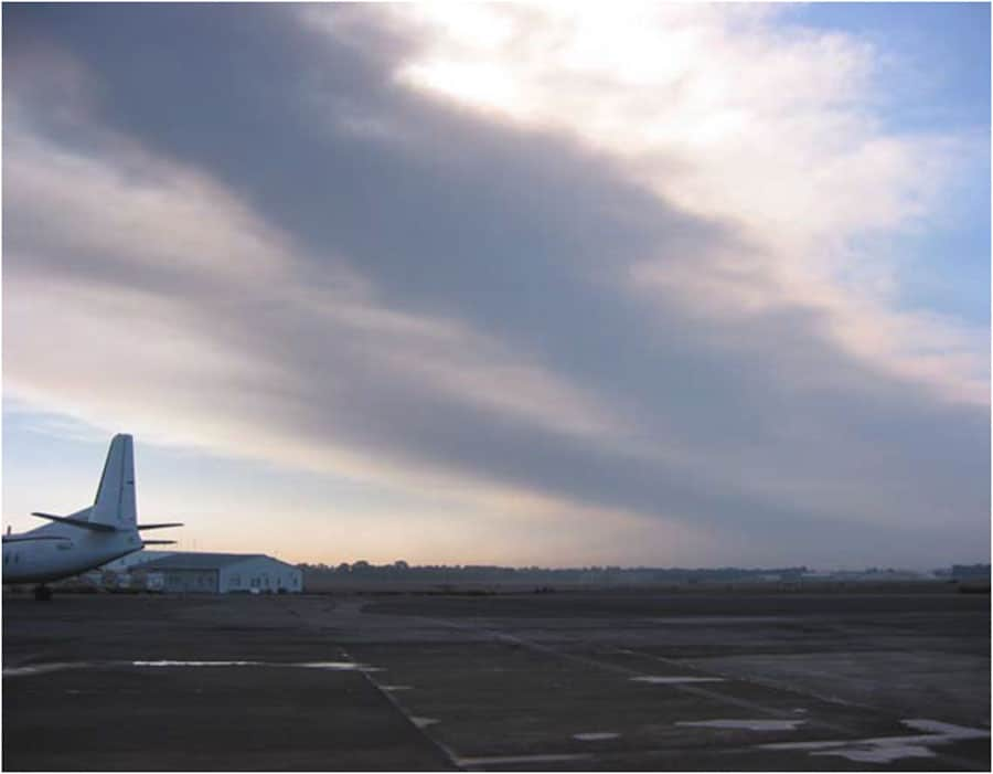 Dark ash from Mt. Etna covering runways at Catania's international airport. Ash fall from Mt. Etna, 30 km from Catania, caused repeated closures at the airport over a 3-month period beginning late October 2002. Photo: Mauro Coltelli . Public domain via USGS.
