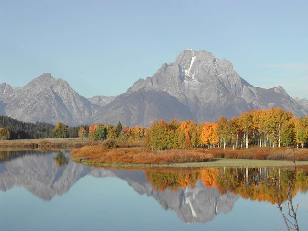 Oxbow Bend in the fall.  The reflection of Mount Moran can be seen in the water.  Photo: NPS, Grand Teton National Park, public domain.